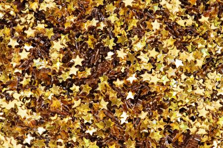 Golden glitter stars textured background Stock Photo