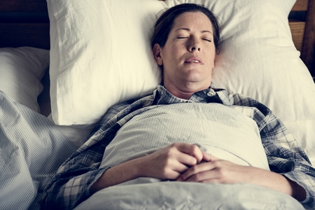 A woman sleeping soundly Stock Photo