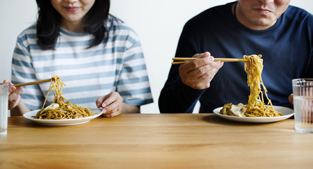 Couple eating noodles together