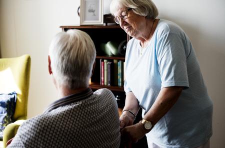 Senior couple, elderly woman taking care of an elderly man Standard-Bild - 109662486