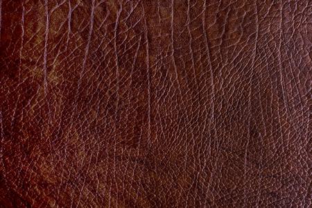 Brauner strukturierter Hintergrund des rauen Leders