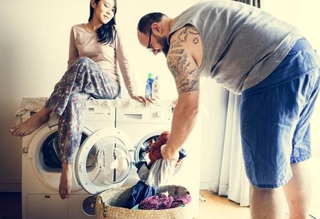 Couple doing a laundry Stock Photo