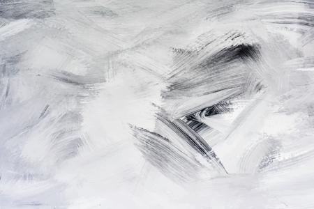 Schwarze Farbe auf einer Leinwand