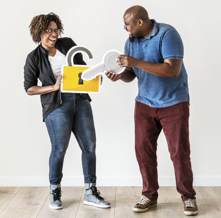 Black couple with security lock and key