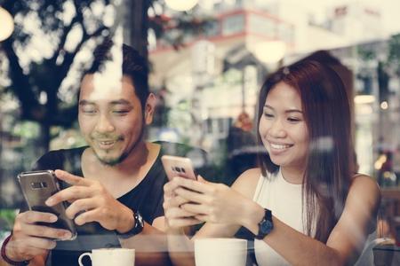 Lovely Asian couple having coffee Reklamní fotografie - 109689031