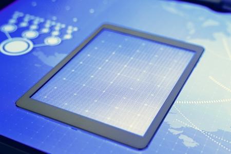 Digital tablet on a cyber space desk
