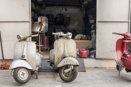 Old scooter parked on a street