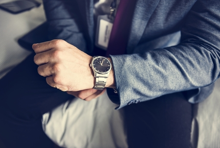 A man putting on a watch