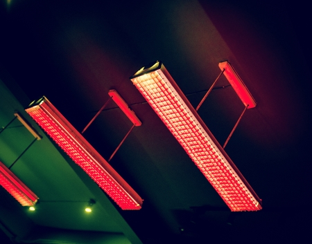 Red fluorescent lamp hanging from the ceiling