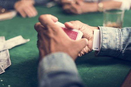 A cheat player in a gambling card circle