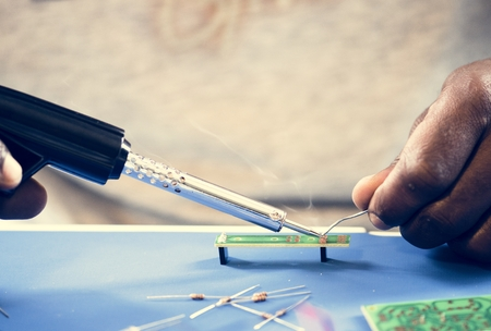 Closeup of tin soldering with electronics circuit board Stock Photo