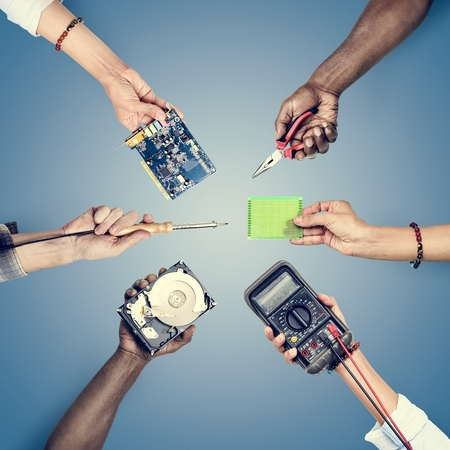 Hands holding digital component isolated on background