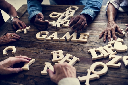A wooden alphabet word game on wooden table Stockfoto - 109641377