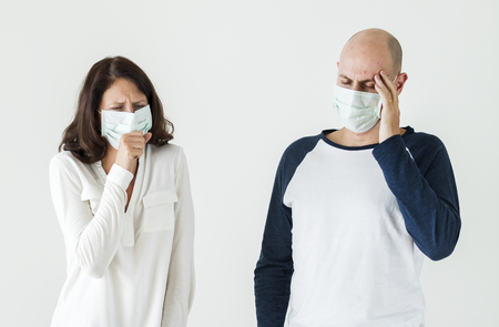 Sick couple wearing surgical mask
