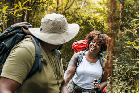 Couple trekking in the forest together Stock fotó - 109642442