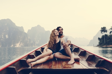 Couple boating on a quiet lake
