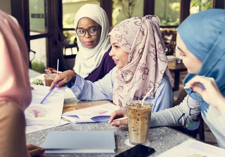 Muslim women doing an assignment together