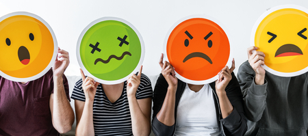 Diverse people holding emoticon Stock Photo - 109642778