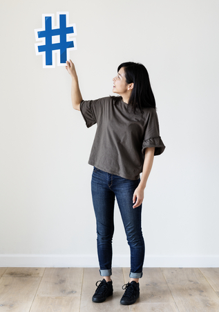 Woman holding a social network icon