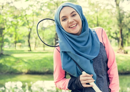 Muslim woman with a badminton racket Stock fotó