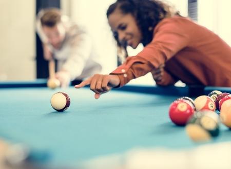 Happy friends playig pool together Archivio Fotografico - 109643163