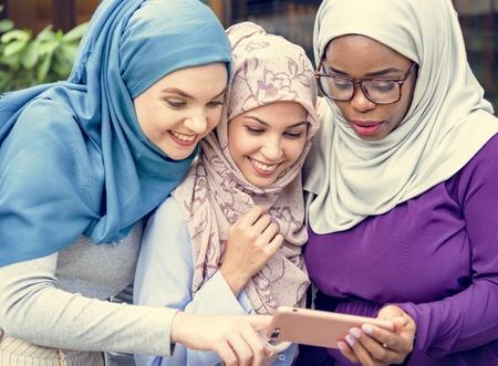 Muslim women looking at a phone