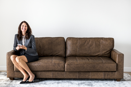 Businesswoman sitting alone on the couch Stock Photo