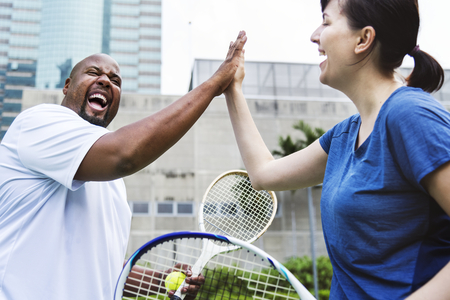 Couple playing tennis as a team Stok Fotoğraf - 109643707