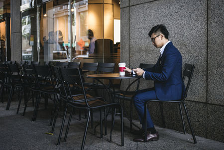 Asian businessman in a cafe Banco de Imagens