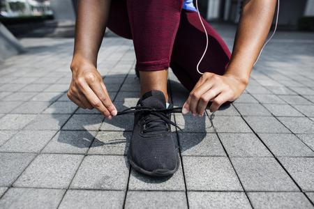 Sporty person checking shoelaces 版權商用圖片
