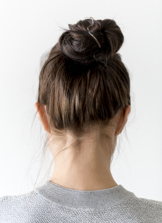 Woman making hair bun