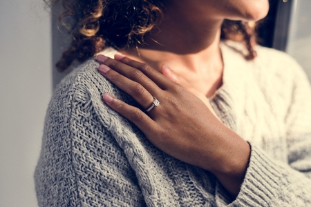 Cheerful woman with engagement ring Stock Photo - 109643830