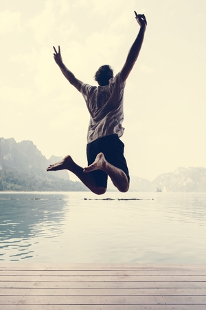 Happy man jumping with joy Banco de Imagens