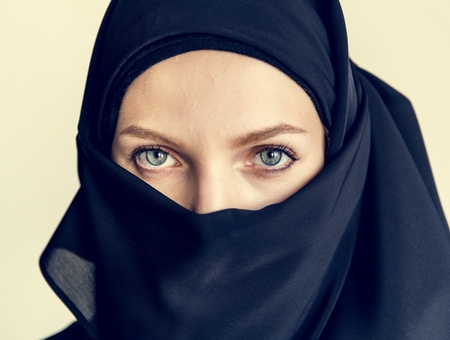 Close up of covered arabian woman Stock Photo