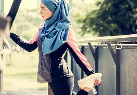 Muslim women exercising outdoors