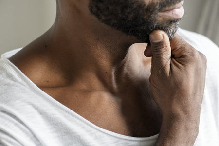Black man thinking and contemplating concept 版權商用圖片
