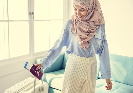 Muslim woman holding her passport