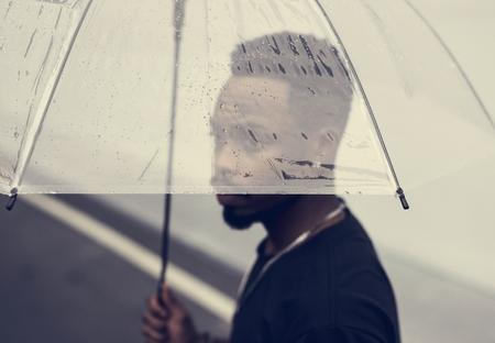 African man using an umbrella