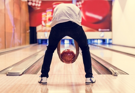 Boy bowling with two hands Banco de Imagens - 109887301