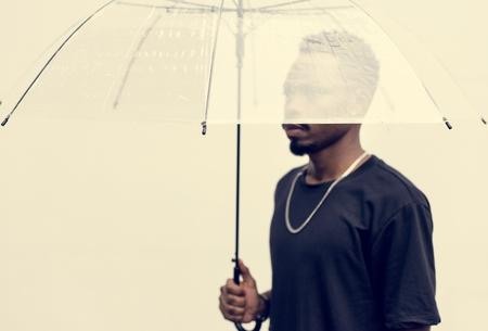 African man using an umbrella Reklamní fotografie - 109887672