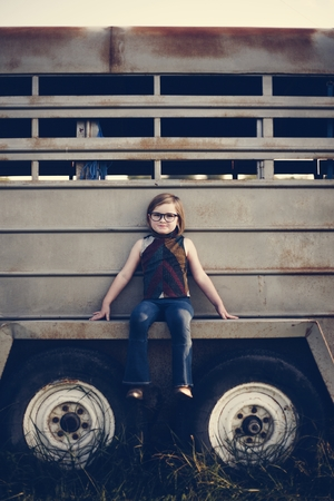 A young girl is having fun in the farm Stock Photo