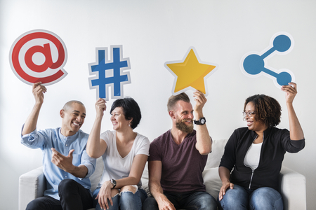 People holding an social media icon Stock Photo