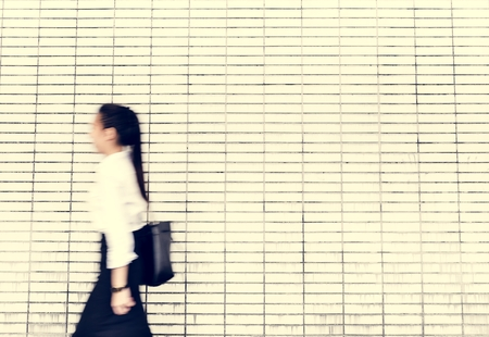 Asian businesswoman in a rush