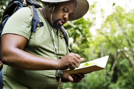 Botanist making notes in his notepad Stock fotó