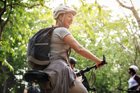 Happy woman on her bicycle Stock Photo