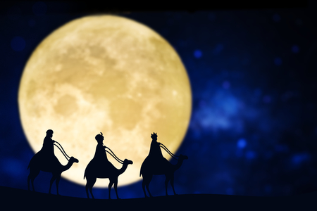 Three wise men silhouette over a full moon Фото со стока