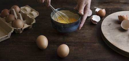 Woman whisking eggs food photography recipe idea Reklamní fotografie