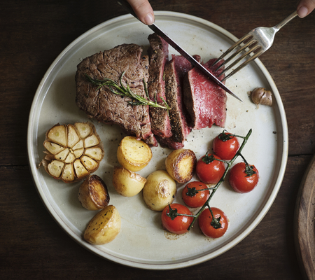 Close up of a cutting a fillet steak food photography recipe idea Reklamní fotografie