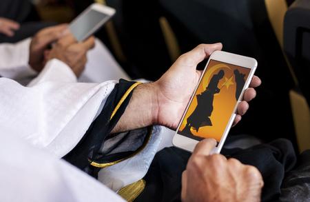 Arabic man looking at his phone Reklamní fotografie