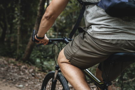 Rear view of male cyclist in the forest